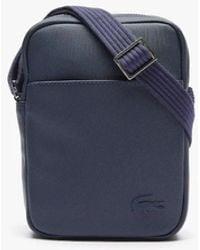 Lacoste Classic Vertical Pouch With Zip In Solid Colour Petit Piqué - Blue