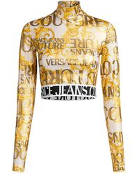 Versace Jeans Logo Printed Metallic Turtleneck Cropped Top