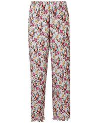 MSGM - Pantaloni plissettati a fiori - Lyst
