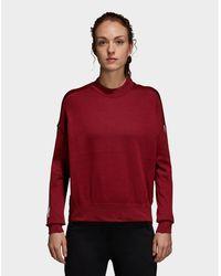 61749c9e7c Lyst - adidas Shrug Sweater in Pink