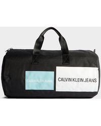 Calvin Klein Jeans Patch Barrel Bag - Black