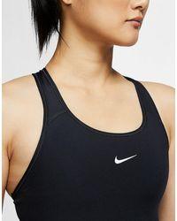 Nike Brassière de sport à maintien normal avec coussinet une pièce Dri-FIT Swoosh - Noir