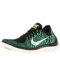 Nike - Free 4.0 Flyknit Black/sail/vltg Green/lcky Grn Running Shoe 5.5 Women Us - Lyst