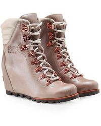 1c06b6b79c09 Sorel - Leather Conquest Wedge Holiday Boots - Lyst