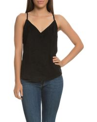 NANA JUDY The Lola Faux Suede V Neck Cami Top With Cross Over Eyelet Back In Black