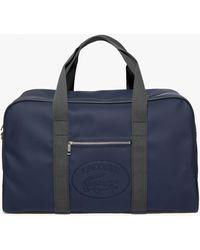 Lacoste 1930's Original Embossed Lettering Weekend Bag - Blue