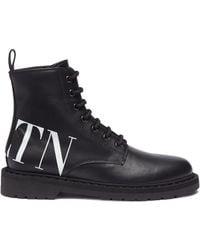 Valentino Logo Print Leather Combat Boots