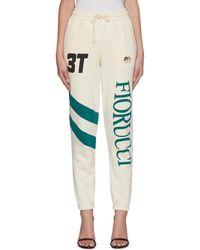 Fiorucci Vintage Logo Print Diagonal Stripe Jogger Pants - White