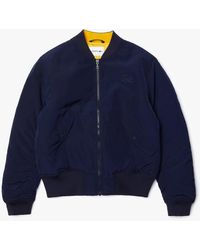 Lacoste - Bomber acolchada con cremallera, impermeable, lisa - Lyst