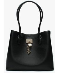 f69a110712 Lyst - DKNY Pebble Leather Small Satchel Bag in Black