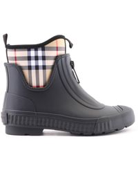 70ac17f35 Lyst - Burberry Charlton Check Booties in Natural