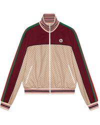 Gucci Giacca in jersey con stampa logo GG - Neutro