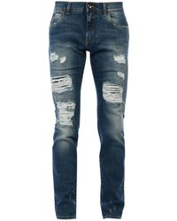 Dolce & Gabbana - Jeans skinny con strappi - Lyst