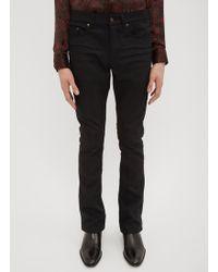 Saint Laurent Coated Boot Cut Jeans In Black