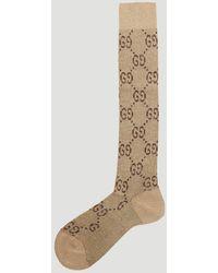 Gucci Metallic Interlocking G Motif Calf Socks In Beige - Natural