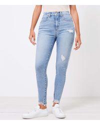 LOFT - Curvy Chewed Hem High Rise Skinny Jeans In Pure Light Indigo Wash - Lyst