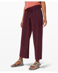 lululemon athletica On The Fly 7/8 Wl Pant Woven - Red