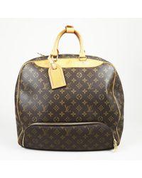 6b67538e4854 Lyst - Louis Vuitton Evasion Monogram Canvas Large Travel Hand Bag ...