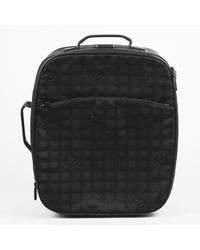 "Chanel Quilted 'cc' Canvas ""travel Ligne"" Suitcase"