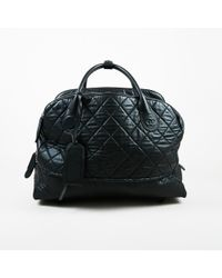 """Chanel Black Quilted Multi Compartment """"rolling Weekender"""" Bag"""