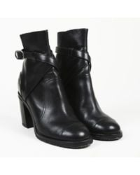 Chanel - Black Metallic Leather Ankle Boots - Lyst