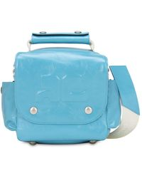 Courreges Embossed Logo Patent Leather Travel Bag - Blue