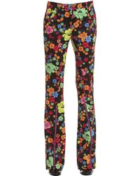 Boutique Moschino - Boot Cut Floral Printed Interlock Pants - Lyst