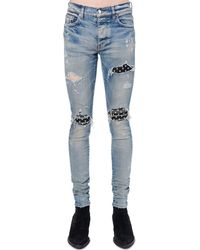 Amiri Jeans Tapered Fit Mx1 Playboy In Denim 15cm - Blu