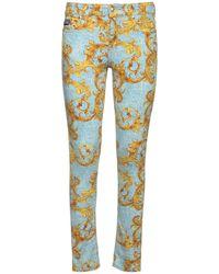 Versace Jeans Couture Enge Jeans Aus Baumwolldenim Mit Druck - Blau