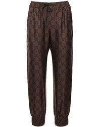 Gucci Gg Supreme Print Silk Twill Sweatpants - Brown