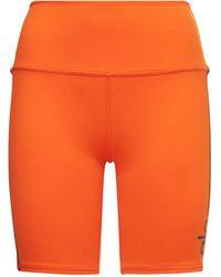Alo Yoga ハイウエストサイクリングショートパンツ - オレンジ