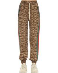 Gucci Gg Viscose Blend Jacquard Track Trousers - Brown