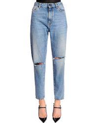 Saint Laurent - Baggy Asymmetric Rips Washed Denim Jeans - Lyst