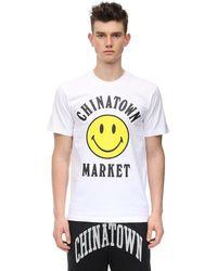 Chinatown Market Smiley コットンジャージーtシャツ - ホワイト