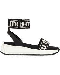 a8fef14687f Miu Miu Logo Strap 75 Satin Wedge Sandals in Natural - Lyst
