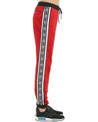 Andrea Crews New Man Logo Side Bands Track Trousers - Red