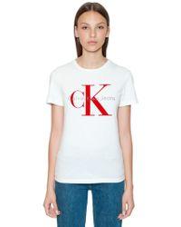 Calvin Klein Jeans - Ck Flocked Logo Cotton T-shirt - Lyst