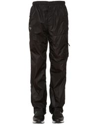 Givenchy - Nylon Track Trousers With Logo Patch - Lyst