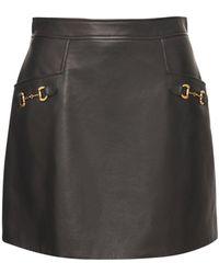 Gucci シャイニーレザースカート - ブラック