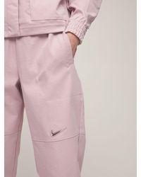 Nike Gewebte Technohose Mit Swoosh - Pink