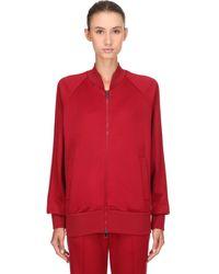 Moncler Jacke aus einem Baumwollgemisch - Rot
