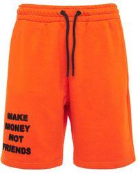 MAKE MONEY NOT FRIENDS コットンジャージースウェットハーフパンツ - オレンジ