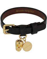 Alexander McQueen Pulsera con detalle de calavera - Negro
