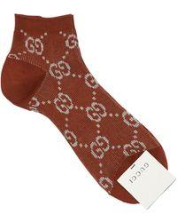 Gucci Socken aus GG Lamé - Braun