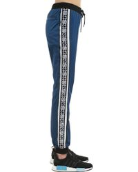 Andrea Crews New Man Logo Side Bands Track Trousers - Blue