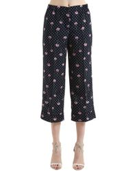 Miu Miu Pantalones con estampado floral - Azul