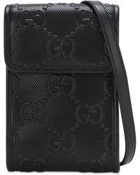 Gucci Bolso cruzado con GG en relieve - Negro