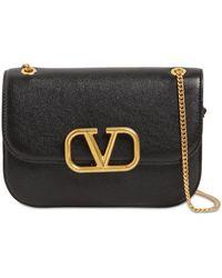 Valentino Garavani コレクション ブラック Vロック バッグ