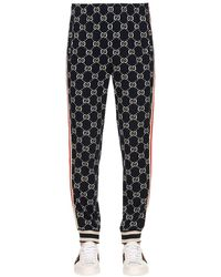 Gucci Gg Jacquard Logo Track Trousers - Blue