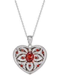 Macy's - Garnet (2 Ct. T.w.) And Diamond (1/10 Ct. T.w.) Locket Pendant Necklace - Lyst